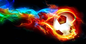 عکس با کیفیت توپ فوتبال در حال حرکت با نورهای رنگارنگ و درخشان نشان دهنده سرعت توپ