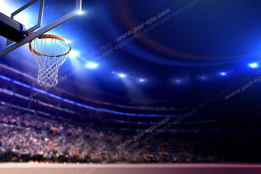 عکس با کیفیت نمایی از ورزشگاه بسکتبال با نورهای آبی روشن و صندلی های پر از تماشاگران و هواداران