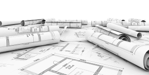 عکس با کیفیت نقشه های لوله شده معماری و طراحی ساختمان روی میز همراه با نقشه های باز شده