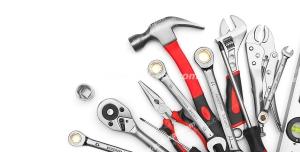 عکس با کیفیت ابزار آلات تکنسین های برق و مکانیک و شیرآلات چیده شده از گوشه تصویر با دسته های قرمز و مشکی