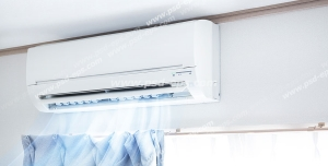 عکس با کیفیت کولر گازی و اسپلیت در حال سرمایش و خنک کردن اتاق