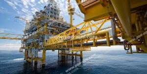 عکس با کیفیت نمایی از ایستگاه نفتی یا سایت شرکت های نفت یا چاه نفت دریایی به رنگ های زرد و سفید