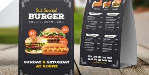 تراکت یا پوستر یا منوی لایه باز تبلیغاتی مشکی رنگ ساندویچی و فست فود با تصویر همبرگر ، سوسیس و...
