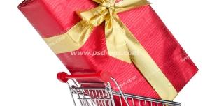 عکس با کیفیت نمادین هدیه خرید از فروشگاه ها با کاغذ کادوی قرمز و روبان زرد درون سبد خرید
