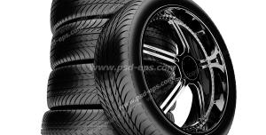 عکس با کیفیت تایرهای خودرو چیده شده بر روی هم در کنار تایری عمودی با رینگ اسپرت