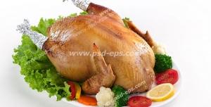 عکس با کیفیت مرغ شکم پر درون بشقاب چینی و تزئین شده با زر ورق ، کاهو، گوجه و لیمو