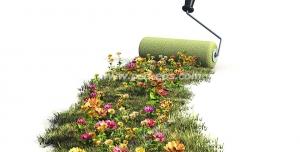 عکس با کیفیت غلطکی در حال کشیدن ردی از گل های زیبا و چمن بر روی زمین