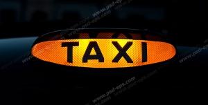 عکس با کیفیت علامت زرد کابین بیضی شکل TAXI برای بالای خودرو و تاکسی های شهری