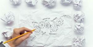 عکس با کیفیت تبلیغاتی طراحی چرخ دنده و کاغذ های مچاله شده