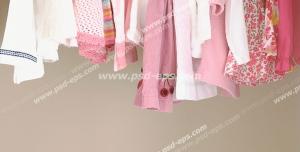 عکس با کیفیت تبلیغاتی کمد لباس های نوزادی صورتی و سفید