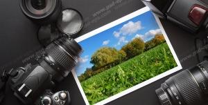 عکس با کیفیت دوربین عکاسی حرفه ای در کنار لنزهای حرفه ای ، فلش و عکس چاپ شده از طبیعت