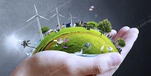 عکس با کیفیت تبلیغاتی تکه از کره زمین روی دست که روی آن توربین بادی و درخت قرار دارد