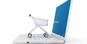 عکس با کیفیت تبلیغاتی سبد چرخدار خرید فروشگاهی کوچک به روی صفحه کلید لپ تاپ