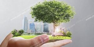 عکس با کیفیت تبلیغاتی یک تکه از زمین در دستان مرد یا پس زمینه خاکستری