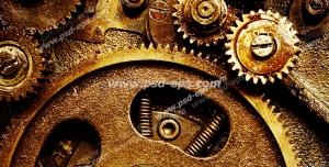 عکس با کیفیت تبلیغاتی یک چرخ دنده بزرگ با چرخ دنده های کوچک در حال چرخیدن در اطراف آن