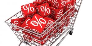 عکس با کیفیت تبلیغاتی سبد چرخدار فروشگاهی که با مکعب های قرمز رنگ که روی شش وجه آن درصد حک شده است