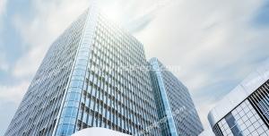 عکس با کیفیت تبلیغاتی ساختمان مرتفع از زاویه پایین و پرتو های نور
